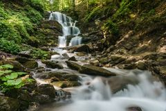 Waterfall `Whisper` in the Carpathians, Ukraine Stock Photo