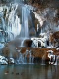 Waterfall in winter. A view of lake and frozen waterfall in winter Royalty Free Stock Images