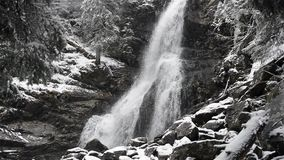 Waterfall in winter cold with ice and snow stock video