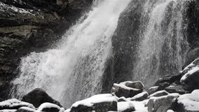 Waterfall in winter cold with ice and snow stock video footage