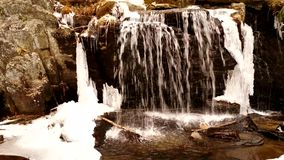 Waterfall in Winter. A Waterfall flows in the Mountains of North Carolina stock video