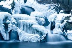 Waterfall at winter. Half-frozen waterfall at winter season Stock Image