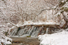 Waterfall Winter Landscape. Snowy winter landscape of waterfall at Big Hill Springs Stock Photos