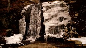 Waterfall in Winter. A Mountain Waterfall flows in the Appalachians stock footage