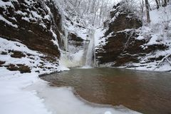 Waterfall in the winter. Season. Waterfall in ice and snow Stock Image