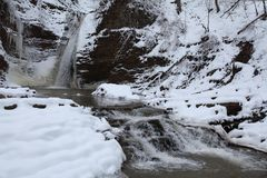 Waterfall in the winter. Season. Waterfall in ice and snow Stock Photography