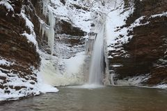 Waterfall in the winter. Season. Waterfall in ice and snow Stock Images
