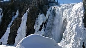 Waterfall in winter. View of a waterfall under a beautiful winter day in Quebec Canada Stock Photo