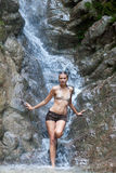 Waterfall with woman in bikini Royalty Free Stock Images