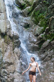 Waterfall with woman in bikini Stock Photo