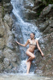 Waterfall with woman in bikini Stock Photography