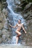 Waterfall with woman in bikini Stock Photography