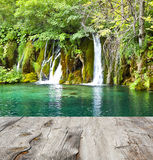 Waterfall and wood pier Royalty Free Stock Photography