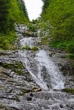 Waterfall in the woods royalty free stock photos