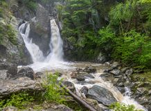 The waterfall in the woods. Bash Bish Falls flows deep in the woods in Mount Washington, Massachusetts stock photos