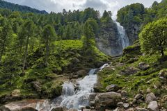 Waterfall in the woods, springs season. Big Waterfall in the forest, spring season near the little ancient village of Sonogno in Switzerland Royalty Free Stock Image
