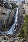 Waterfall in Yosemite National Park. Beautiful waterfall turns into river that flows from it, in Yosemite Royalty Free Stock Photos