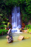 Waterfall in zen garden royalty free stock image