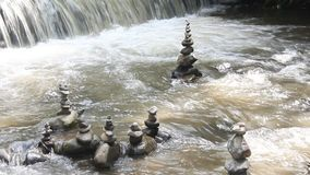 Waterfall and zen stones stock video footage