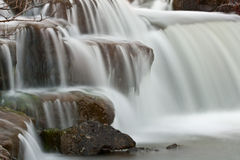 Waterfalling over cascade Royalty Free Stock Images