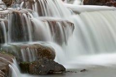 Waterfalling sobre a cascata imagens de stock royalty free