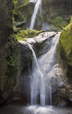 Waterfalls. Two alpine waterfalls coming down from the top of the rocks into this carsic hole Stock Photo