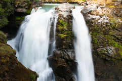 Waterfalls. North Fork of Nooksack River dropping into deep, rocky gorge from green eddying pool. Nooksack Falls Hydroelectric Project, Mount Baker Snoqualmie Royalty Free Stock Image
