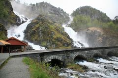 Waterfalls above bridge Stock Image