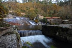 Waterfalls and ancient water mills stock image