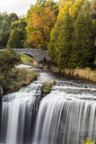 Waterfalls by the Bridge. Websters Falls in autumn with stone bridge Stock Photo