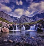 Waterfalls With Brown Mountain Range on Background Royalty Free Stock Photo