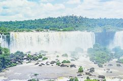 Waterfalls from Cataratas do Iguacu on the city of Foz do Iguacu. Foz do Iguacu, Brazil - January 07, 2018: Waterfalls from Cataratas do Iguacu, Brazil Royalty Free Stock Images