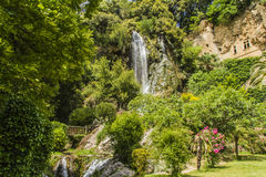 Waterfalls and caves troglodytes. Waterfall and caves troglodytes Villecroze in Provence Stock Images
