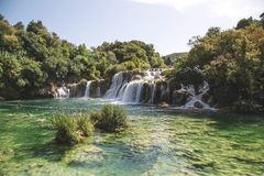 Waterfalls in clear pool Stock Photography