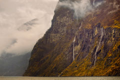 Fjord Waterfalls, Cliffs and Fog,  Norway Royalty Free Stock Images