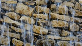 Waterfalls dripping and flowing down rock wall closeup. stock video footage