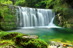 Waterfalls Emerald Lake Forest Landscape. Emerald Lake - Beautiful scenery of forest waterfalls landscape flowing in summer stock image