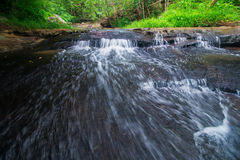 Waterfalls flowing from the forest. Royalty Free Stock Images