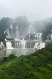 Waterfalls in fogs. In China Stock Image
