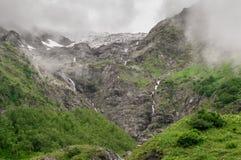 Waterfalls with fogs. Beautiful high-mountain waterfalls with fogs Royalty Free Stock Images