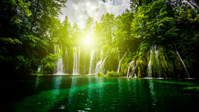Waterfalls in the forest. And sunlight stock photos