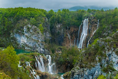Waterfalls in forested mountains. Scenic view of cascading waterfalls in forested mountains Royalty Free Stock Image