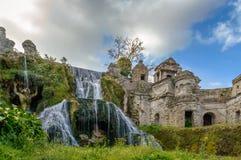 Waterfalls fountain with greek gods in Tivoli, Italy Royalty Free Stock Photography