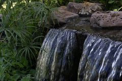 waterfalls, garden arrangement, waterfalls in the garden. royalty free stock photos