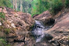 Waterfalls in green forests. With large rock cliffs during the dry season Royalty Free Stock Photos