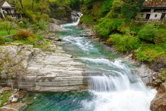 Waterfalls In Front Of Lavertezzo Village, Famous Tourist Destination - An Old Swiss Village With Double Arch Stone Bridge Royalty Free Stock Image