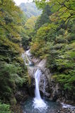 Waterfalls in japan. In contact with nature, breathing fresh air, arduous hiking up and down the mountain trails Royalty Free Stock Image