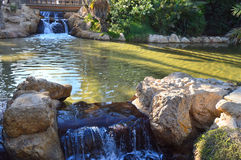 The waterfalls and lake in Palmeral park Alicante Stock Photo