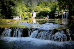 Waterfalls. Landscape with a powerful waterfalls and a green trees royalty free stock photo