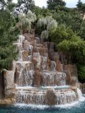 Waterfalls in a landscaped garden. Full view of a man-made waterfalls in a landscaped garden royalty free stock photo